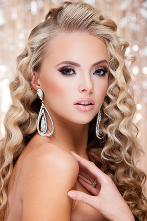 prom: Young lady with luxury accessories on sparkling background