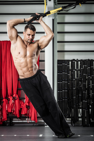 functional: Young man streching muscles making functional training Stock Photo