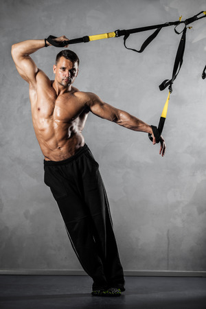functional: Young man stretching muscles making functional training Stock Photo