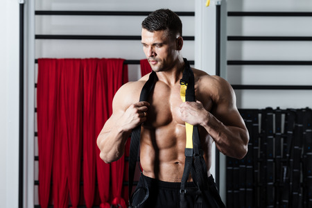 Young man streching muscles making functional training Stock Photo