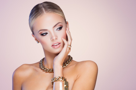 jewelry chain: Young lady with luxury accessories on beige background