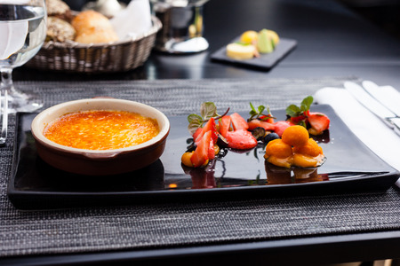 brulee: Creme brulee with strawberry foam and sea buckthorn sorbet Stock Photo