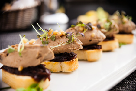 goose: Homemade duck liver patee with cedar nuts, dried plums, bruschetta and red onion jam Stock Photo