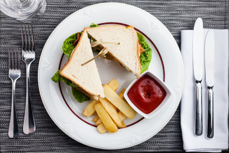 fried eggs: Sandwich with fried eggs, bacon and lettuce served with french fries and ketchup