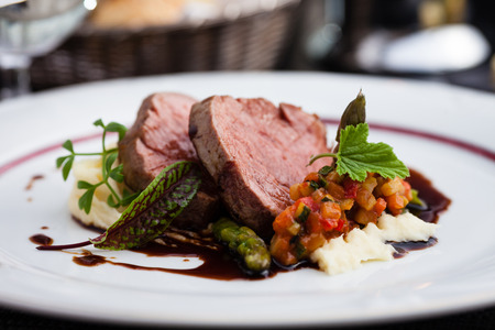 Veal fillet with vegetable ratatouille, parsnip puree, asparagus and bone marrow sauce