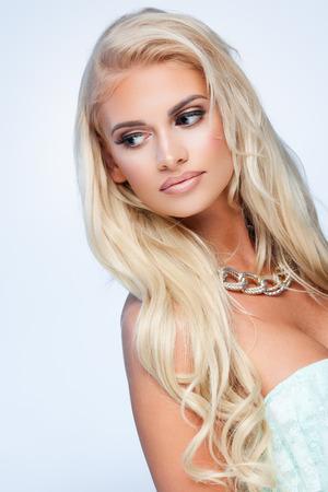 ringlet: Portrait of beautiful female model on beige background