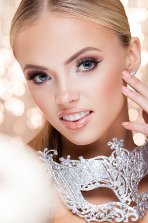 glamour luxury: Young lady with luxury accessories on sparkling background