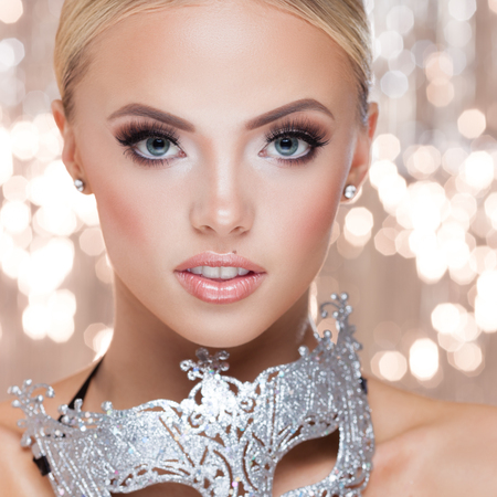 Young lady with luxury accessories on sparkling background