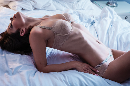 women breast: Beautiful lady in sexy lingerie lies in bed