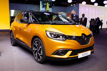 mpv: Geneva, Switzerland - March 1, 2016: Renault Scenic, front-side view presented on the 86th Geneva Motor Show in the PalExpo