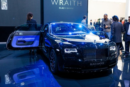 wraith: Geneva, Switzerland - March 1, 2016: Rolls Royce Wraith Black Badge Edition, front view presented on the 86th Geneva Motor Show in the PalExpo Editorial