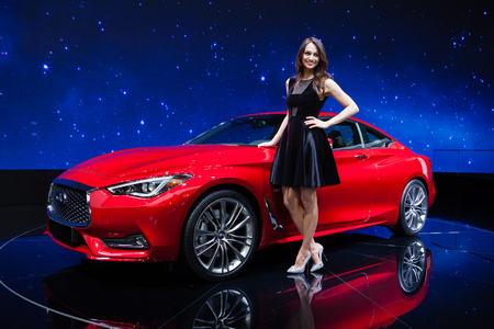 Geneva, Switzerland - March 1, 2016: Infiniti Q60, front-side view presented on the 86th Geneva Motor Show in the PalExpo