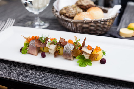 cream cheese: Salted and marinated herring on creamy cheese, beer and black bread chips, potatoes and red caviar