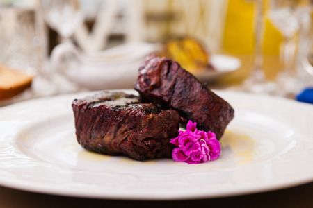 fillets: Filet mignon served on a plate in restaurant