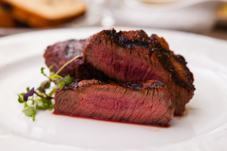 mignon: Filet mignon served on a plate in restaurant