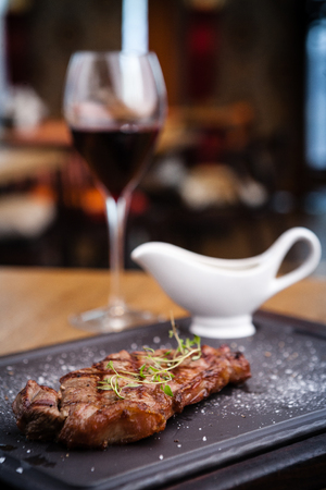 glass of red wine: New York steak with glass of red wine
