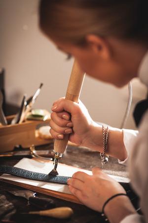 saddler: Leather handbag craftsman at work in a workshop