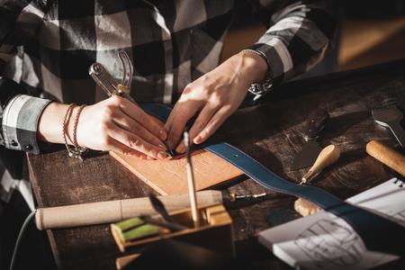 Leather handbag craftsman at work in a workshop Stock Photo - 63492873
