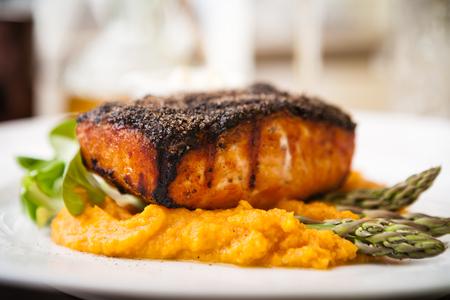 sweet potato: Salmon steak with asparagus and sweet potato mash served on white plate