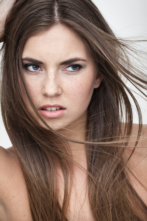 abomination: strong facial expression concept - young woman portrait with displeased negative grimace on her face