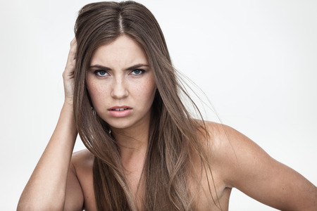 abomination: strong facial expression and emotion concept - young woman portrait with displeased negative grimace on her face