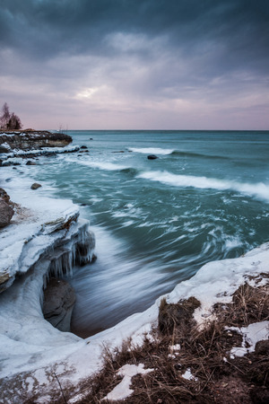ove: Sunset ove the stormy sea in winter