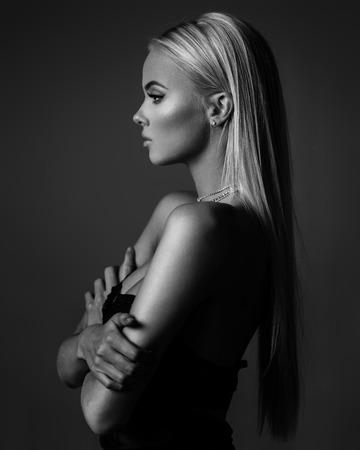 hair model: blond hair on grey