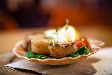 seared: Fried scallops with vegetables Stock Photo