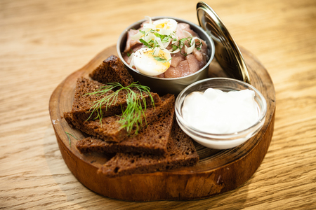 Pickled herring with sour cream Standard-Bild