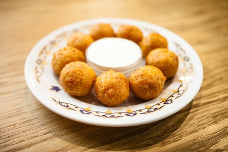 Cheese balls with sour cream