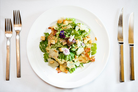 bacon bits: Caesar salad on a plate