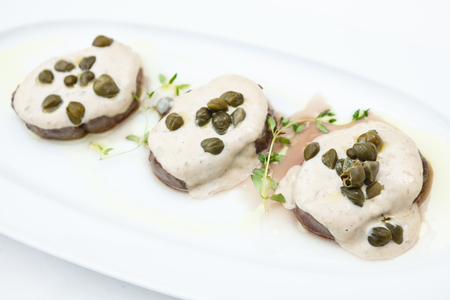 Sliced veal with sauce