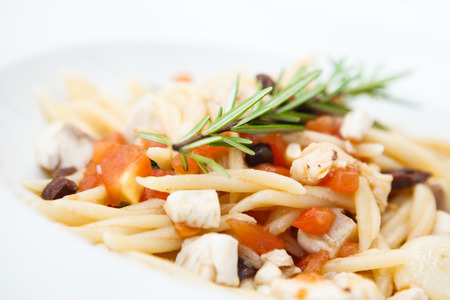 Pasta with sea bream and a juniper branch Stok Fotoğraf