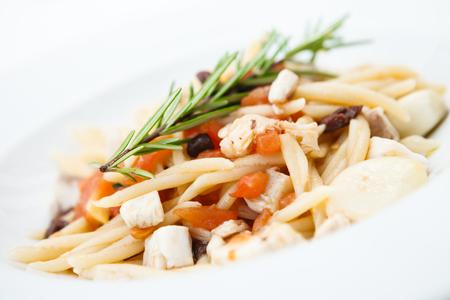 Pasta with sea bream and a juniper branch Stock Photo