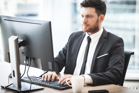 Young businessman in office Stock Photo - 101868387