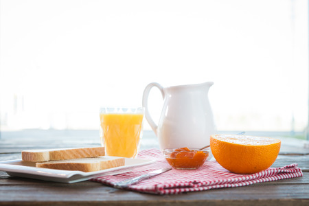 Healthy english breakfast with toasts, orange juice and jam on the table close up Stock Photo - 102578795