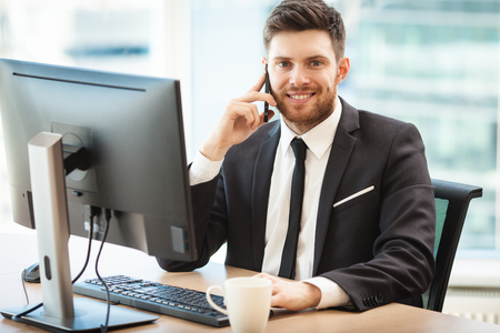 Young businessman in office Stock Photo - 103111491