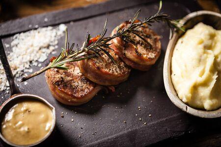 Pork tenderloin served on a board in restaurant