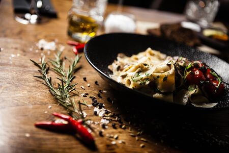 Black Angus Pasta served in a black bowl in restaurant Фото со стока - 134086865