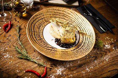 Black Angus tenderloin steak covered with 24 carat gold Stock Photo