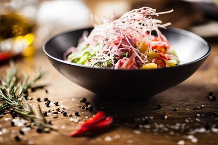 Poke with beef: Glass noodle, avocado, edamame and mango in a bowl. Delicious healthy food closeup served for lunch on a table in modern gourmet cuisine restaurant.