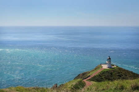 Cape Reinga Lighthouse, most northern part of New Zealand, where Tasman and Pacific ocean meet photo