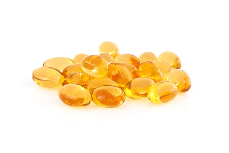 gel capsule: Vitamin E supplement capsules closeup on a white background Stock Photo