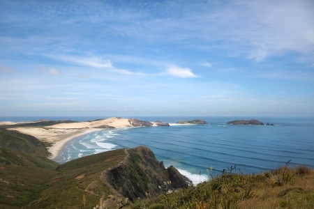 Cape Reinga peninsula, most northern part of New Zealand, where Tasman and Pacific ocean meet photo