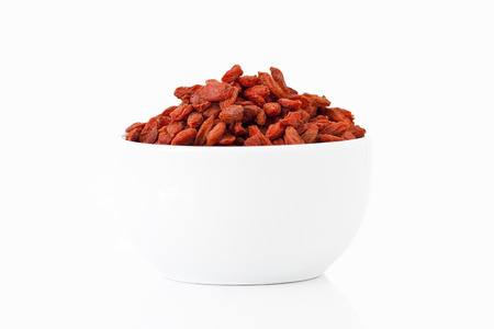 Goji berries in a cup on white background