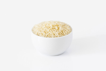 White rice in a bowl on white background photo