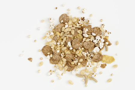 Morning cereal mix from above on white background