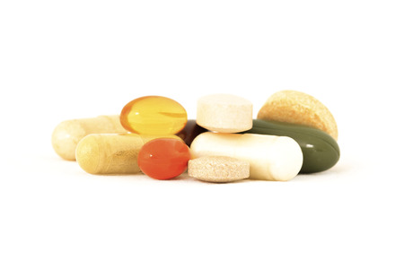 glucosamine: Various vitamins and herbal supplements on white background
