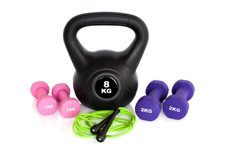 heavy weight: Dumbbells, kettle bell and skipping rope isolated on white background Stock Photo