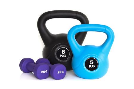 Dumbbells and kettle bells isolated on white background